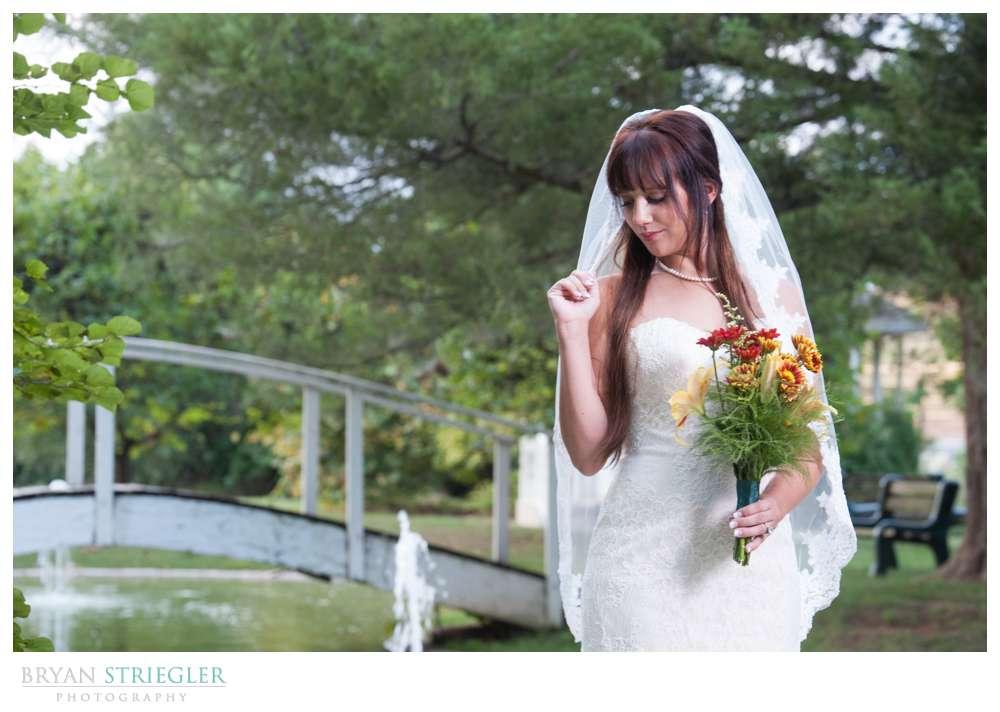 Ashley's Arkansas Bridal Portraits at Magnolia Gardens front of pond