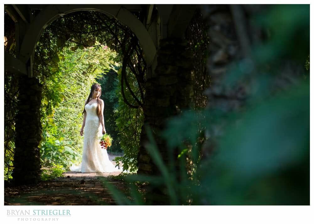 Ashley's Arkansas Bridal Portraits at Magnolia Gardens arch
