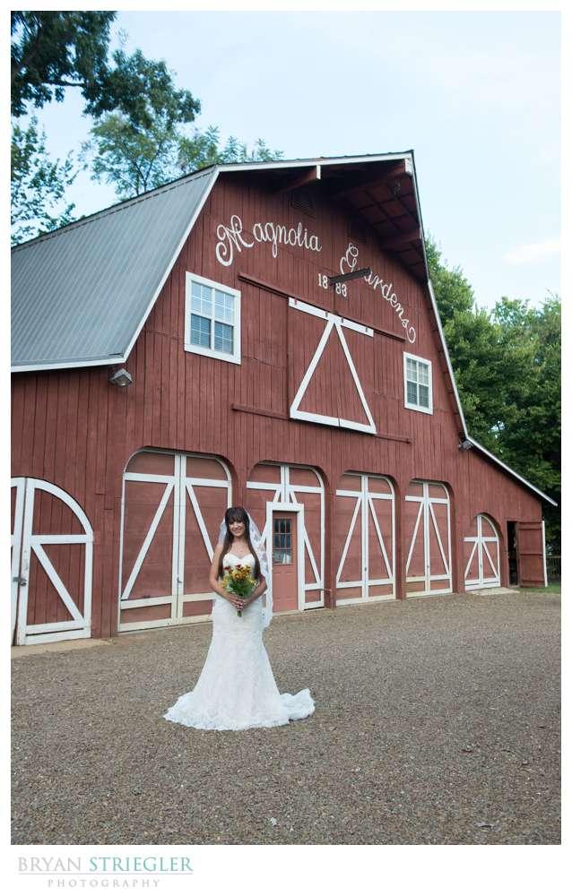 Ashley's Arkansas Bridal Portraits at Magnolia Gardens in front of barn