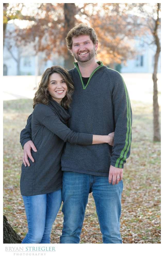 Post wedding portraits hugging husband