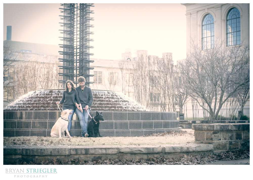 Post wedding portraits sitting by fountain
