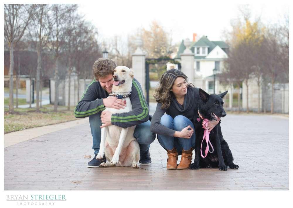 Post wedding portraits hugging dogs