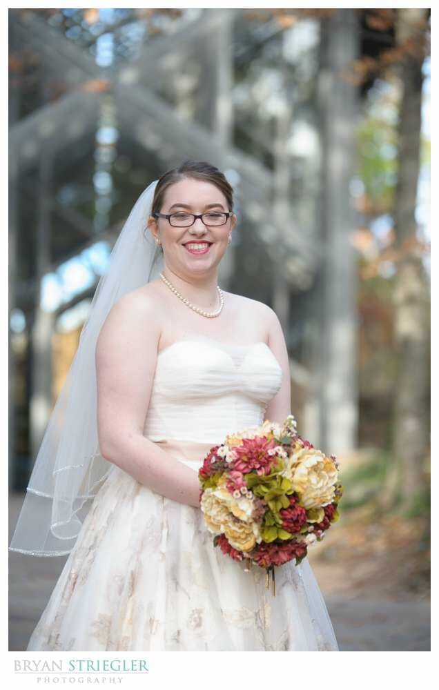 Eureka Springs Wedding Photographer bride in front of Thorncrown chapel