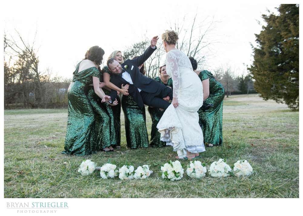 Fayetteville Wedding Photographer picking up groom