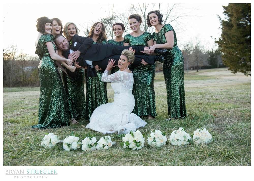 Fayetteville Wedding Photographer girls holding groom
