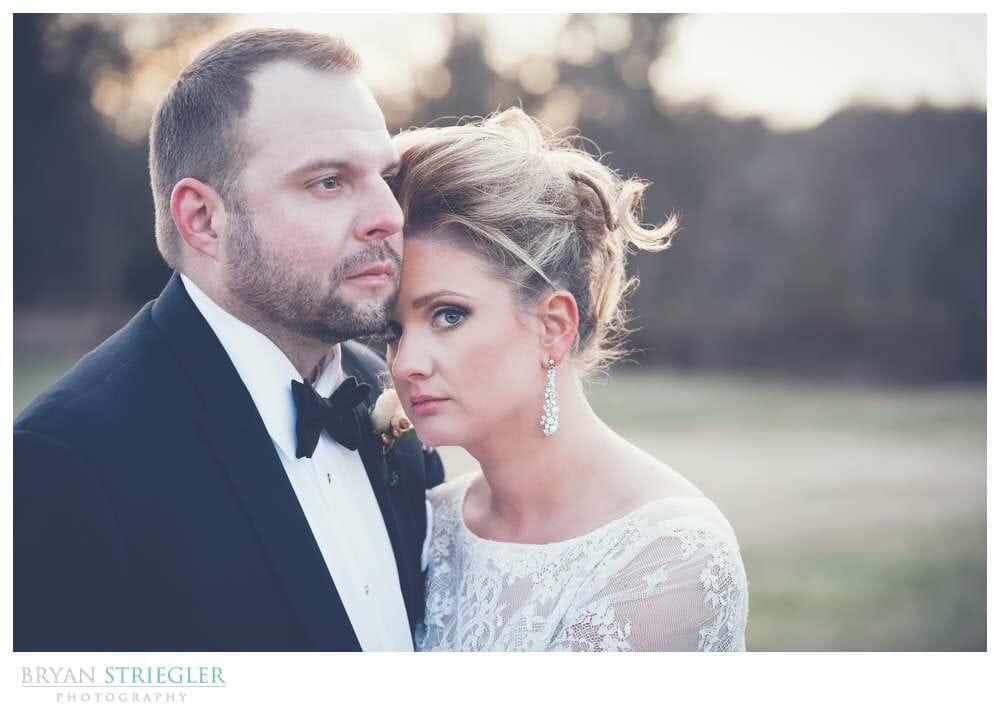 Fayetteville Wedding Photographer bride leaning on husband