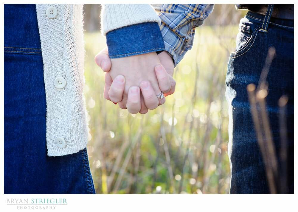 Shooting Winter Engagement Photos holding hands up close