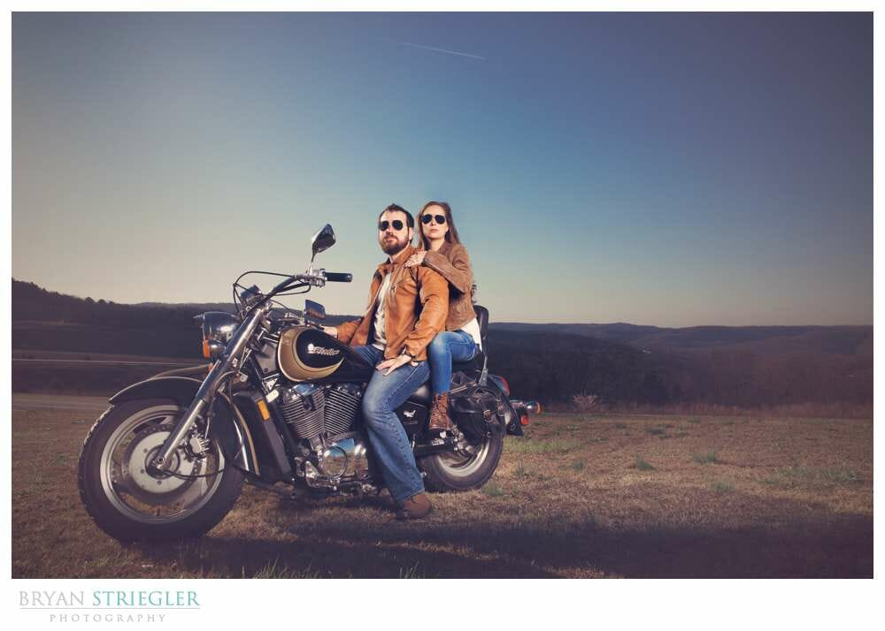 Unique Engagement Photos on motorcycle with blue sky