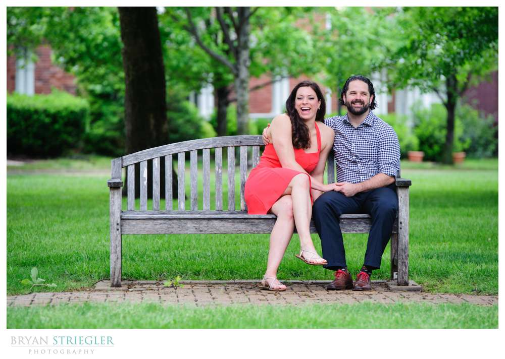 Arkansas Crossfit Engagement Photos laughing on bench