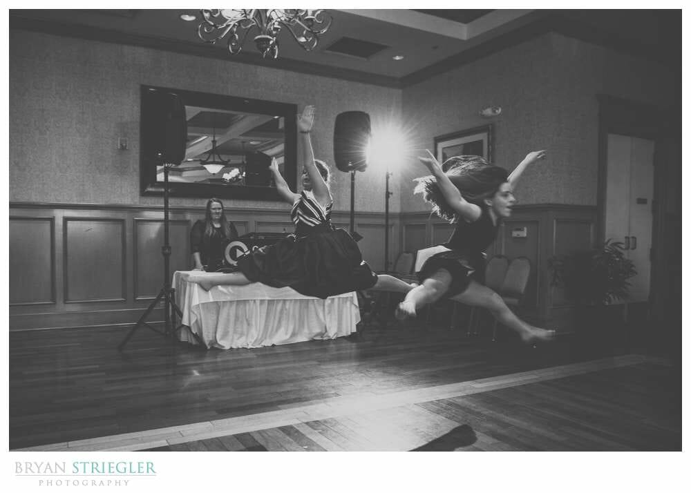 Linda and Chuck's Springdale Country Club Wedding dancing and doing jumps