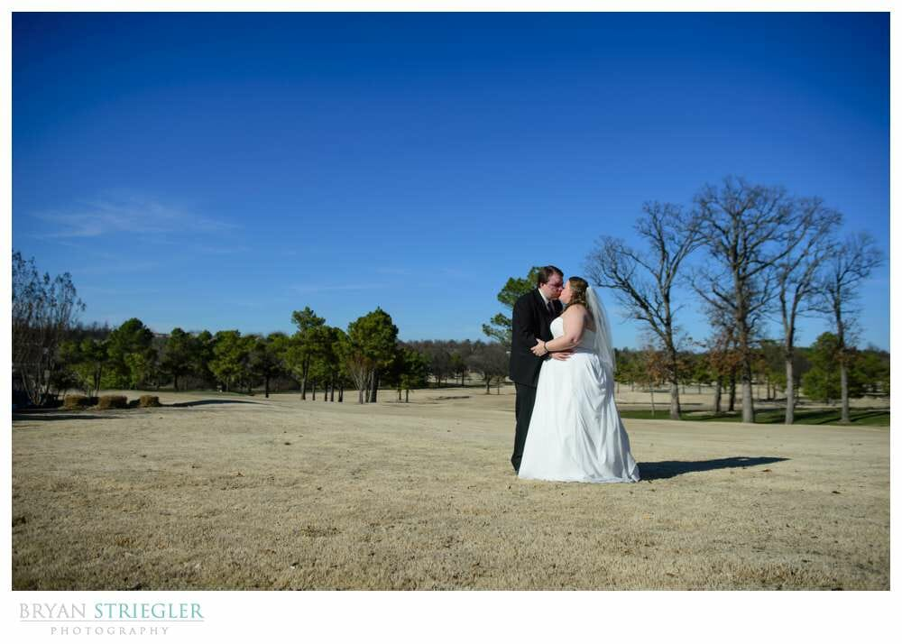 Linda and Chuck's Springdale Country Club Wedding kissing on golf course