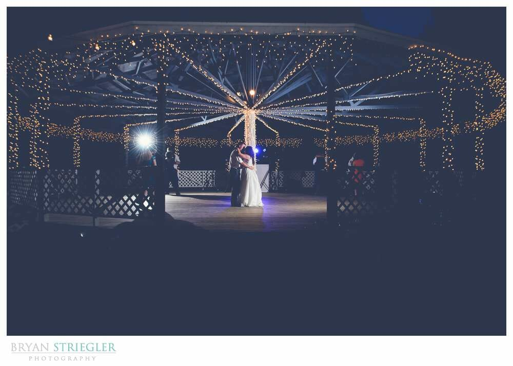 Choosing a wedding venue dancing in the gazebo with Christmas lights