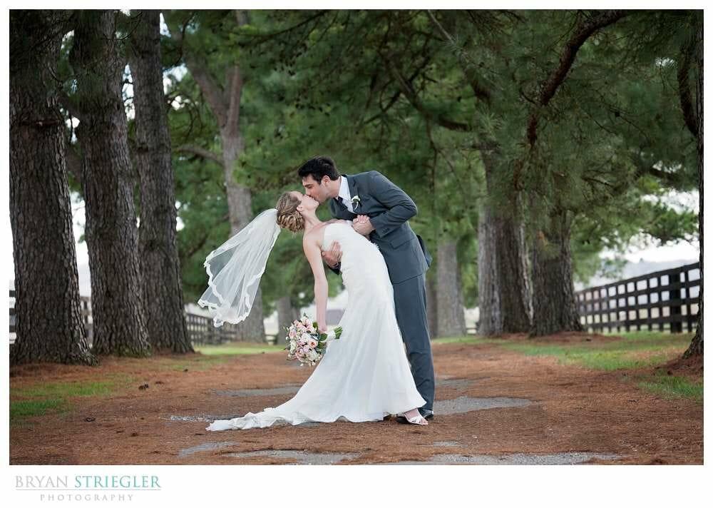 Choosing a wedding venue dipping bride under trees