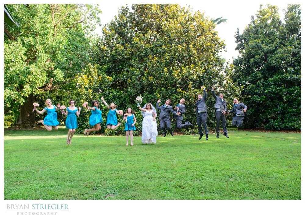 Bridal Party Jumping at Magnolia Gardens