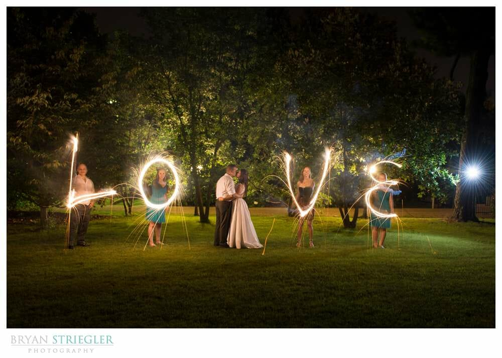 Spelling love with sparklers