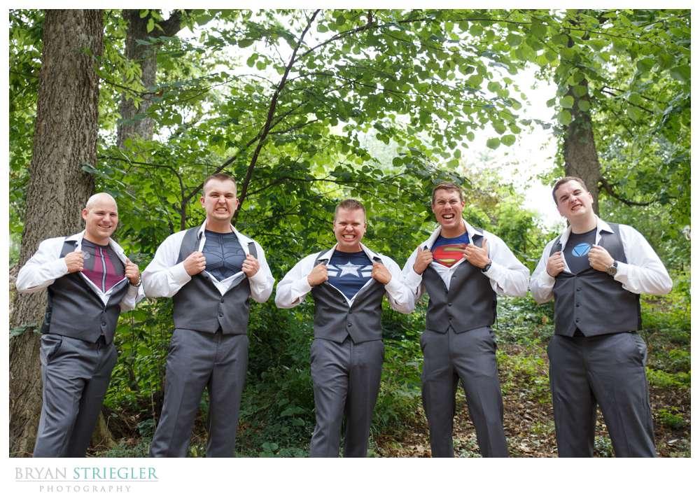 Groomsmen wearing super hero shirts