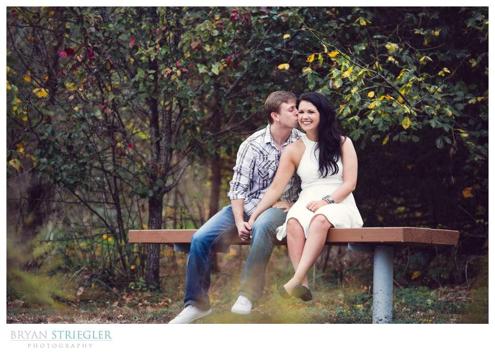 Tanyard Creek Engagement sitting on bench