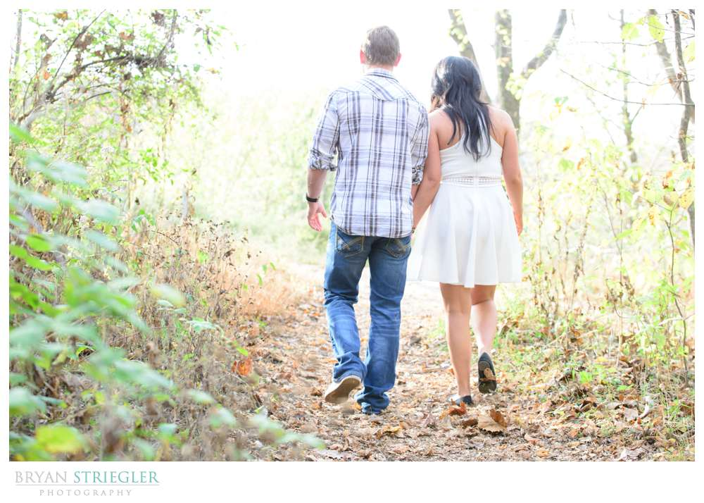 walking away holding hands engagement pictures