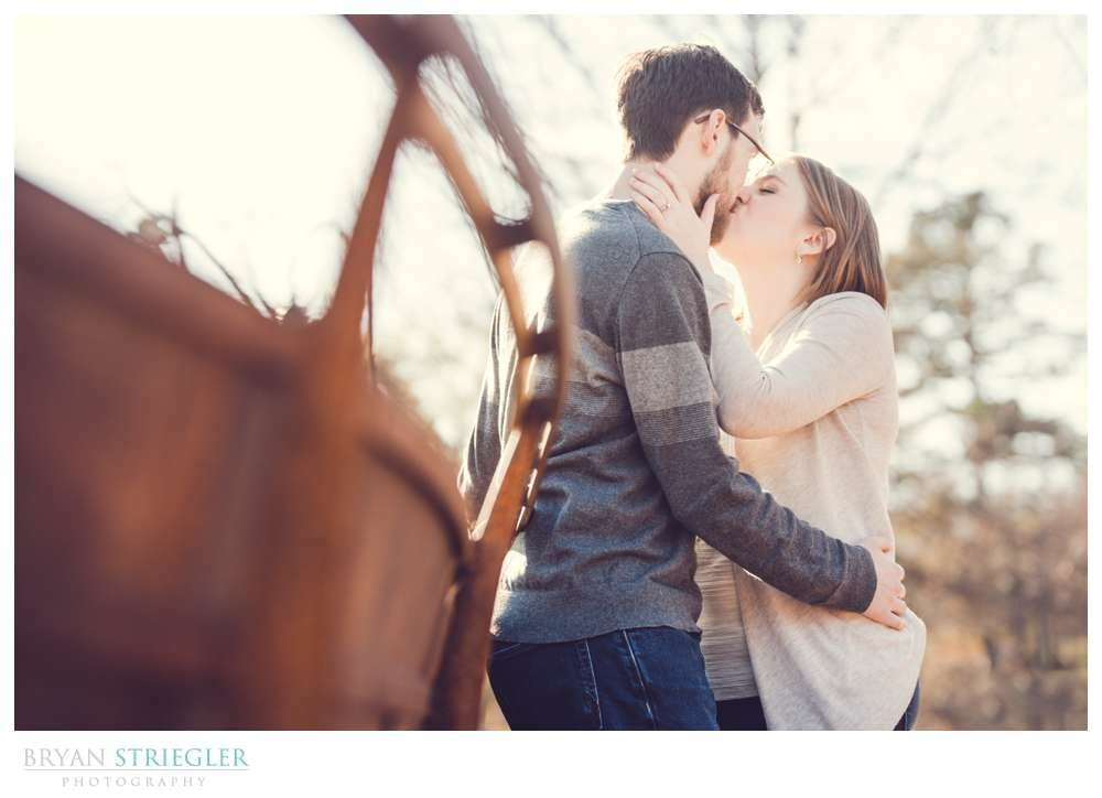romantic engagement photo on bridge