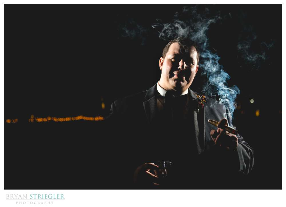 dramatic groom portrait with cigar
