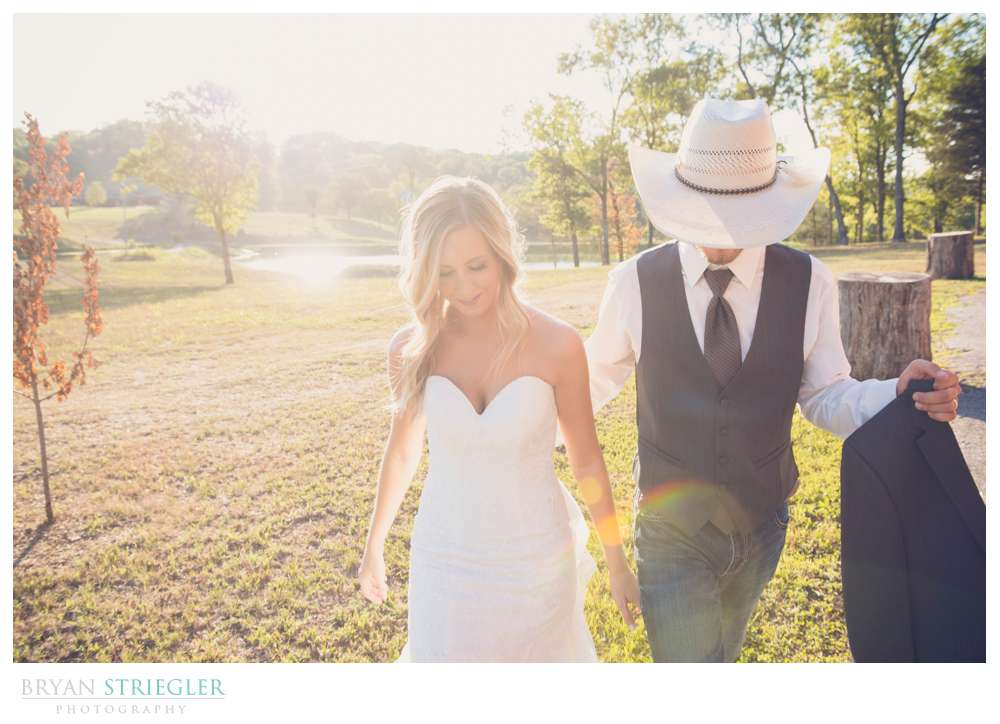 bride and groom walking with backlight