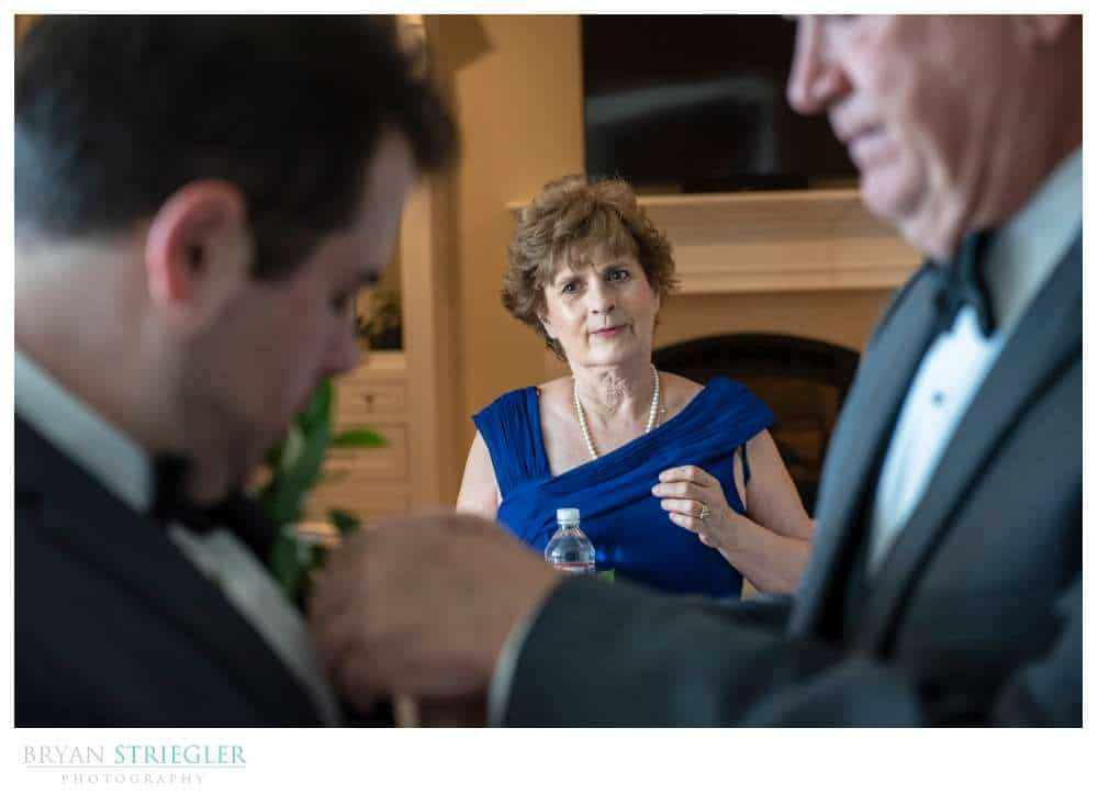 mother watching son at wedding