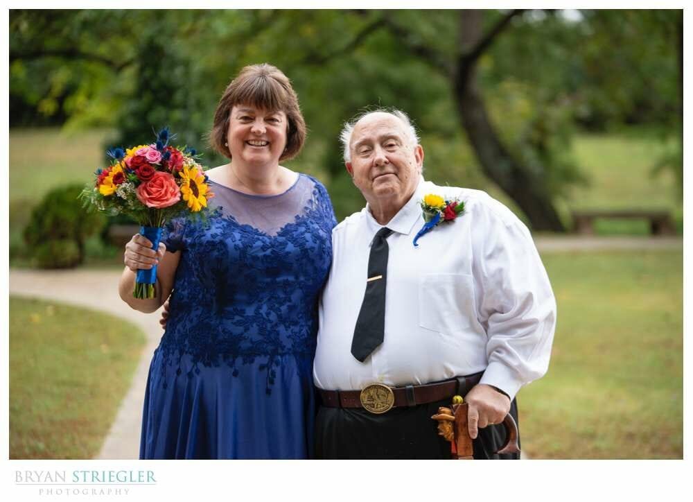 bride with father before wedding ceremony