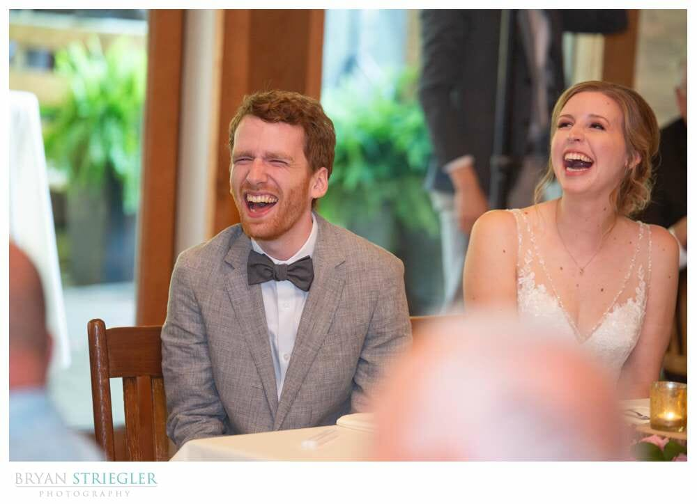 wedding couple laughing during speeches