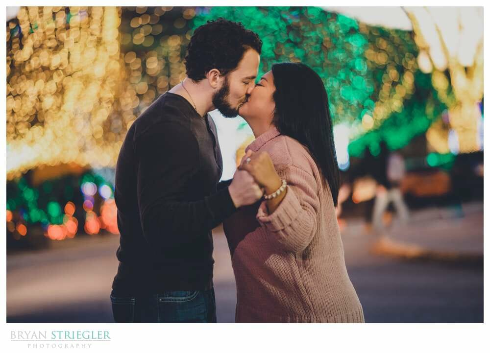 Christmas lights in engagement photo