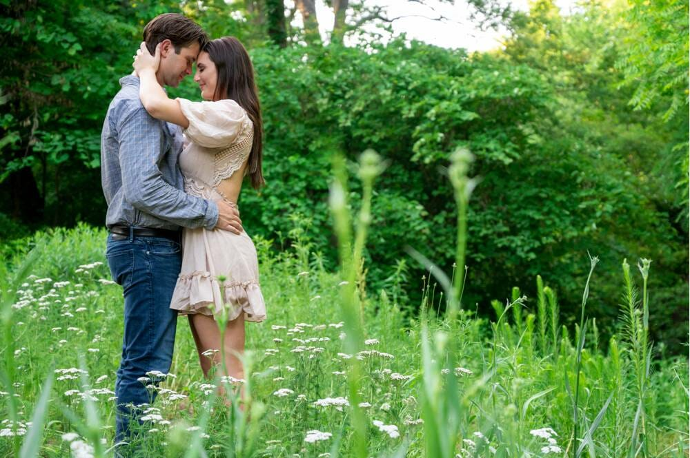couple in high grass during engagement session