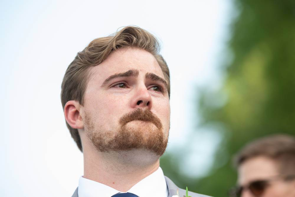 groom's reaction to bride walking down the aisle at Under the Woods