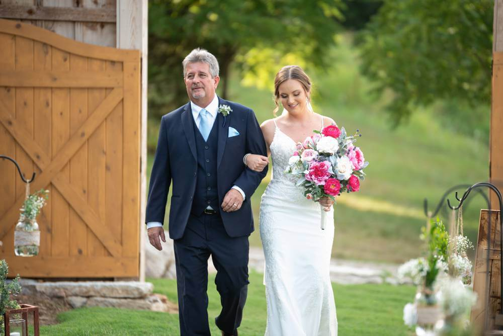 bride walking down the aisle with father
