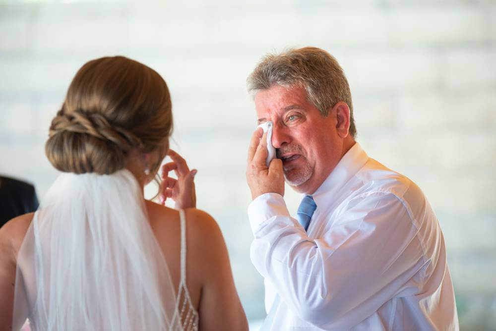 father crying after first look with bride
