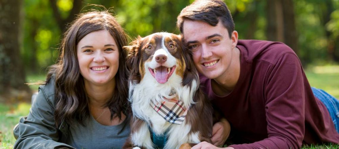 engagement photo with couple and dog